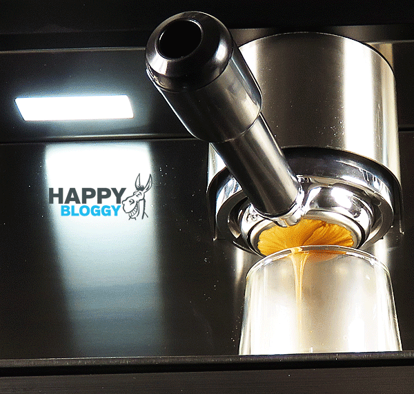 Image displaying up view shot of espresso pouring from a bottomless filterholder