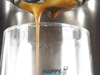 Image displaying pour and coffee drip from bottomless filter holder
